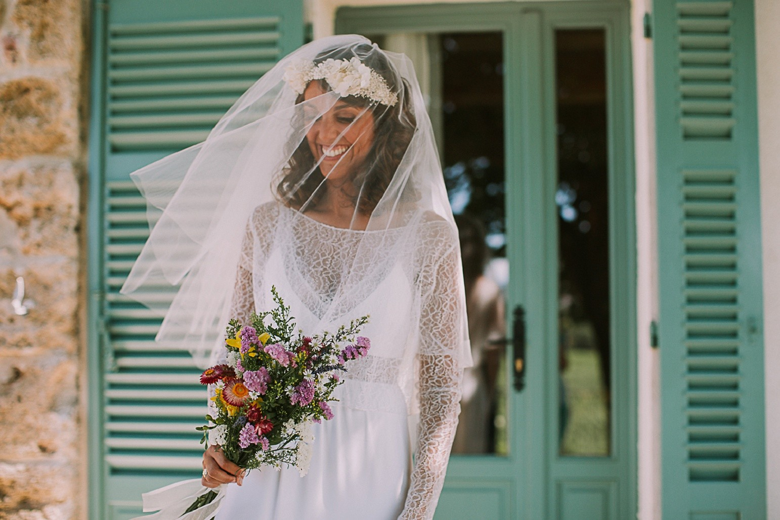 boho-bride-wearing-flower-crown-and rime-arodaky-gown